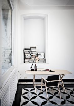 Cassina – Federico Cedrone - Photographer book storage writing nook white walls black and white patterned flooring