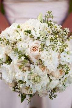 Contents: Vendela cream rose, white scabiosa, white phlox, seeded eucalyptus, white wax flower, and white lisianthus with no buds. Floral Design by Best Day Floral Design   Wedding Bouquet   Wedding Flower Inspiration: Floral Fridays   Elegant All White Bouquet