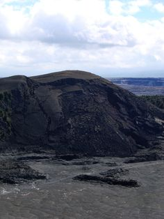 A closer view of the Pu'u Pua'i cinder cone, where you can clearly see post-eruptive slumping; eventually much of the cone may collapse into the crater. The trail that crosses the crater floor passes just in front of the vent.