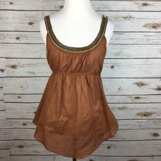 "[Free People] Bead Boho Goddess Tank Tie Back Chic Vintage Free People top! Scoop back tank with bronze tone beading around the top. Ties at back. Loose fit. Curved hem. Looks great layered over a lacy bralette!   Fabric: 100% Cotton  Bust: 19.5"" Length: 26"" Condition: GUC. No major flaws. One or 2 beads missing at top of strap. Hard to notice. Tried to show in last photo!   No Trades! Free People Tops Tank Tops"