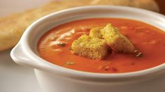 Cosi Tomato Basil Soup (4 servings)  1 tbsp olive oil  3 cloves garlic, minced  1 6oz can tomato paste  1 28oz can diced/crushed tomatoes, drained  2 cups cream, heated  ¼ cup chopped basil  2 tsp sugar  1 tsp garlic powder  ¼ tsp white pepper  Salt  Heat oil in pan, med heat Sauté garlic Add tomato paste Stir,cook for 30 secs Add drained tomatoes, cover, simmer 15 mins Remove from heat,cool slightly. Puree, stir in heated cream, basil, sugar, garlic powder,pepper and salt to taste.