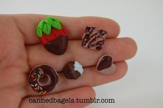 A bunch of assorted earrings (chocolate themed!) by cannedbagels.tumblr.com, aka moi.