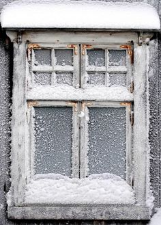 winter is coming... frosted, snowed window pane.