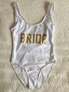 Whether you're heading someone warm for the bach party or you're going to the beach for your honeymoon, this bride bathing suit better be in your suitcase. | Printed Lettering Bathing Suit One Piece | Hen Party Swim Wear | White Bride Bathing Suit | Beach Honeymoon Attire