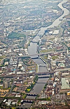 """Where the River Clyde flows through the centre of Glasgow, Scotland. Once it was called """"The Merchant City"""" ."""