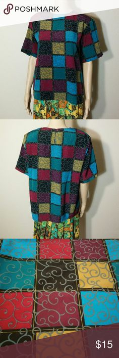 Vintage Jordan Geometric Blouse A stylish straight cut blouse featuring a geometric print in plum, raspberry, turquoise, blue, black, mustard, and gray. Fastens in back with one button. Padded shoulders. No major visible flaws. 24 inches long. Jordan Tops Blouses