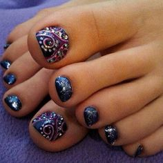 Toenails by nailedbyceline. Navy blue sparkly polish w/ purple swirls and silver polka dot design on big toes. This is cool.