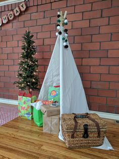 Simple DIY Teepee and pom poms, DIY first birthday, picnic party, Yogi Bear First Birthday,  see more on www.thegracefuljourney.com