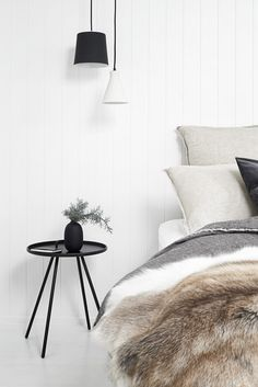 Bedroom styling with lots of textures and layers.  Nord House in Australia is a Scandi style weekend getaway just outside Melbourne designed by Poss Samperi of Orchard Keepers on the Mornington Peninsula.