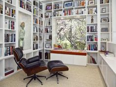 window seat library! - build into the room with bookshelves/cupboards and replace the sliding door with a windowseat.