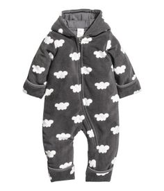 Dark gray/cloud. Lightly padded jumpsuit in soft fleece with a printed pattern and a hood. Zip at front and along one leg. Foldover cuffs and hems to keep
