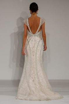 The architectural beading and art-deco lines on this Maggie Sottero dress creates the illusion of curves.