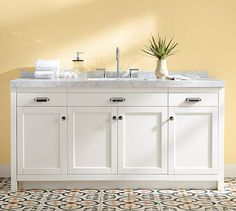 Contrast your white cabinets with beautiful, pale yellow hues.