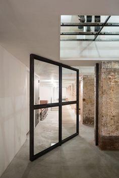 Rotating door at hyper-industrial office space.