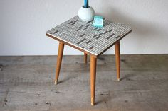 Vintage plant stand/ square small coffee table / flower stool / nightstand / beside side table with a white-brown mosaic optic top. The 4 legs are removable. Original German 50s 60s furniture - Mid Century! This furniture is perfect usable as a side table next to your couch, or as a nightstand.