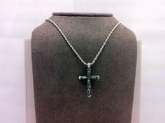 """Turquoise stones line this sterling silver cross. Comes with 16"""" necklace."""