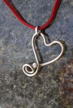 made from a stainless steel bicycle spoke...amazing artist! Bicycle Jewelry Bicycle Spoke Heart by Winterwomandesigns on Etsy