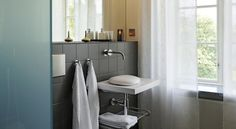 Contemporary bathroom design. Clean, modern fittings with a unique polished stone sink.