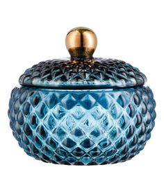 Mørkeblå. Krukke i strukturmønstret glas med låg. Størrelse ca. 10x11 cm.