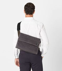 "Our Waxed Twill Atlas Case is a utilitarian shoulder bag inspired by the design of vintage map cases. Constructed from waxed cotton twill, it is abrasion and water resistant. The bag features custom die-cast Jack Spade hardware, and interior organizing pockets. The Atlas Case is perfectly sized for carrying an iPad, and its rain-blocking front flap keeps your belongings dry in a downpour. 9.5""H x 13.9""W x 3.5""D"