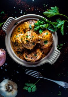 Tender chicken meatballs covered in a decadent paprika sour cream sauce.