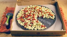 Just because the Super Bowl is over doesn't mean you don't have an excuse to make this pizza popcorn--any occasion will do for this easy recipe: