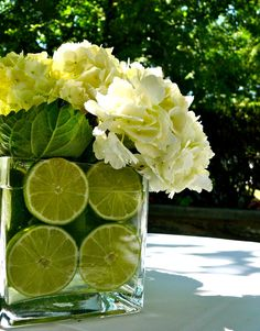 Outdoor cocktail hour. Centerpieces with lime slices and hydrangeas. Spring Garden. Renaissance Westchester in White Plains by Taffeta & Tattoos.