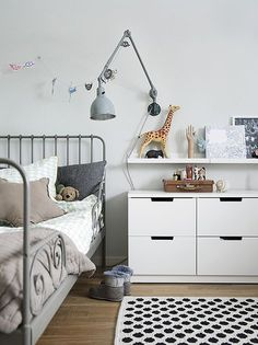 Kids room. IKEA metal frame bed, drawer and shelf above it.