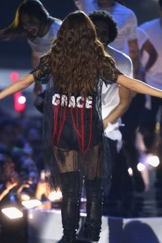 """Selena Gomez wears a """"GRACE"""" on the back of her performance outfit. A dedication to her sister?"""