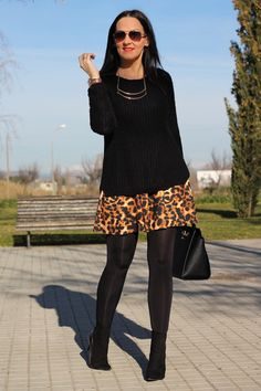 """ANIMAL PRINT SKIRT -  As first seen on blog """"Black Dress Inspiration"""" here: ANIMAL PRINT SKIRT  She is wearing tights similar here: Black Opaque Tights Just in time for cooler temps these opaque tights will keep your legs covered in a no-show shade while the unique knitting technology helps create a smoother-looking silhouette. Now you can experience the next step in hosiery.  #tights #pantyhose #hosiery #nylons #tightslover #pantyhoselover #nylonlover #legs"""