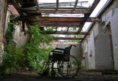 Abandoned Asylums of New England - Wheelchair in the Norwich State Hospital in Connecticut.  Image: John Gray Photography.