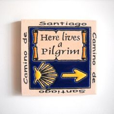 (http://www.spanishdoor.com/camino-de-santiago-here-lives-a-pilgrim-fridge-magnet-tile/)