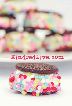 Colorful Ice cream Sandwiches made from Oreo cookies..GREAT party idea from KindredLive.com
