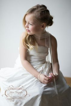 girl in mommy's weddingdress, natural light, window, styled portret, fine art