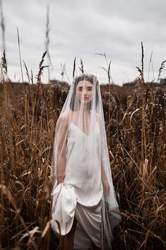 A neutral, minimalist modern bridal editorial in London's Walthamstow marshes. Featuring pops of muted blue and pink, this bridal photoshoot is sure to inspire any stylish bride! Bridal Photoshoot, Bridal Shoot, Bridal Pics, Photoshoot Ideas, Bridal Looks, Bridal Style, Minimalist Wedding Dresses, Wedding Photo Inspiration, Designer Wedding Dresses