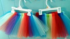 All the colors of the rainbow make this the happiest of tutus.    Tutu is made with a sewn waistband and high quality tulle. Spot clean only, never