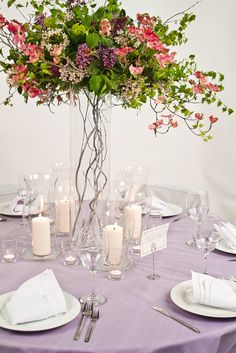 This towering floral centerpiece adds levels to this tablescape