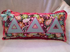 Tri Delta stitched letters on small pillow