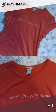 """""""Soon to be Famous"""" tee Old Navy perfect fit tee in Size XL. Orange/coral color . Gently used condition. White lettering """"Soon to be Famous"""". Old Navy Tops Tees - Short Sleeve"""