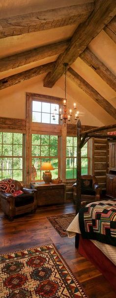 Lodge bedroom with vaulted ceiling and exposed beams.