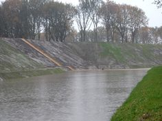 """"""" The Moses Bridge was developed by two architects by the name of Ad Kil and Ro Koster. It was built through a moat that had been made in the Netherlands in the 17th century for protection from Spain..."""