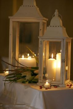 lanterns with white candles on the tables