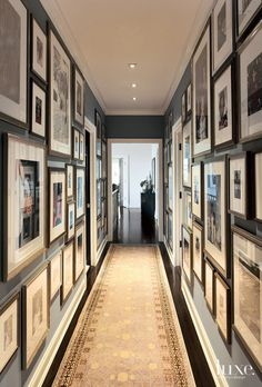 Interior Designer Neal Beckstedt rummaged through cartons of family photos in the attic in order to create a statement-making memory wall in the hallway. Hallway Pictures, Family Pictures On Wall, Hanging Pictures, Wall Photos, Hallway Art, Hallway Walls, Hallways, Rustic Entryway, Entryway Decor