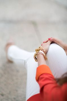 white jeans and bright top with nude heels
