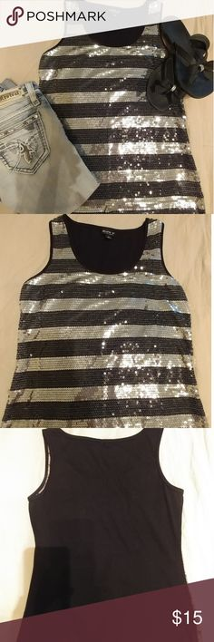 🌼Black/Silver Sequin tank top This black and silver sequin tank top is perfect dressed up or dressed down. Throw on a pair of Jean capris and flip flops and you look chic & classy running those errands! Throw on a pair of white dress pants and heels and you're ready for girls night out 💃 💄 Tops Tank Tops
