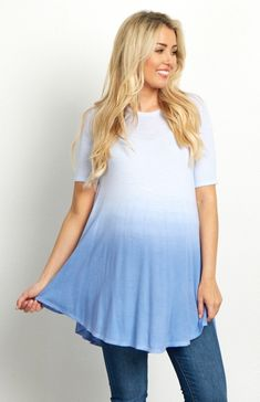 A stunning short sleeve knit maternity tunic to keep you cool when the weather gets warm. The gorgeous hues and faded detail will beautifully accommodate your growing bump by adding a splash of color to your outfit. Style this maternity tunic with leggings and a pair of boots for a complete ensemble.