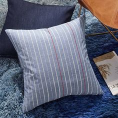 "23"" embroidered light denim pillow, $59.95"