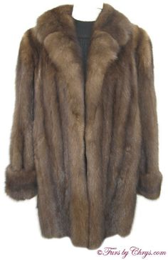 Royal Crown Russian Sable Stroller Jacket; Approx. size estimate: Misses 8 - 12; Excellent condition. This is an extra-luxurious genuine natural Royal Crown Russian sable fur jacket in the versatile stroller length. It has an abundance of silvery tips - an indication of very high quality sable! It is in like new condition, other than having a name monogram embroidered in the lining. It has a Crown Russian Sable label, and features a large notched collar and turn-back cuffs...