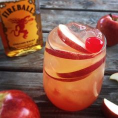 Fireball Cider Bomb Cocktail Fireball Cider Bomb Cocktail Recipe: Ice Cubes (approximately 4 or 5 ice cubes) 2 ounces Fireball Cinnamon Whiskey 3 ounces apple cider cherry grenadine syrup Apple slices Maraschino Cherry Cider Cocktails, Cocktail Drinks, Cocktail Recipes, Fireball Cocktails, Fireball Recipes, Apple Cider Cocktail, Whiskey Recipes, Non Alcoholic Drinks, Beverages
