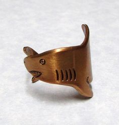 Forget brass knuckles, a brass shark ring is where it's AT — $30.99 | 23 Shark-Inspired Jewelry Pieces You Absolutely Need Right Now